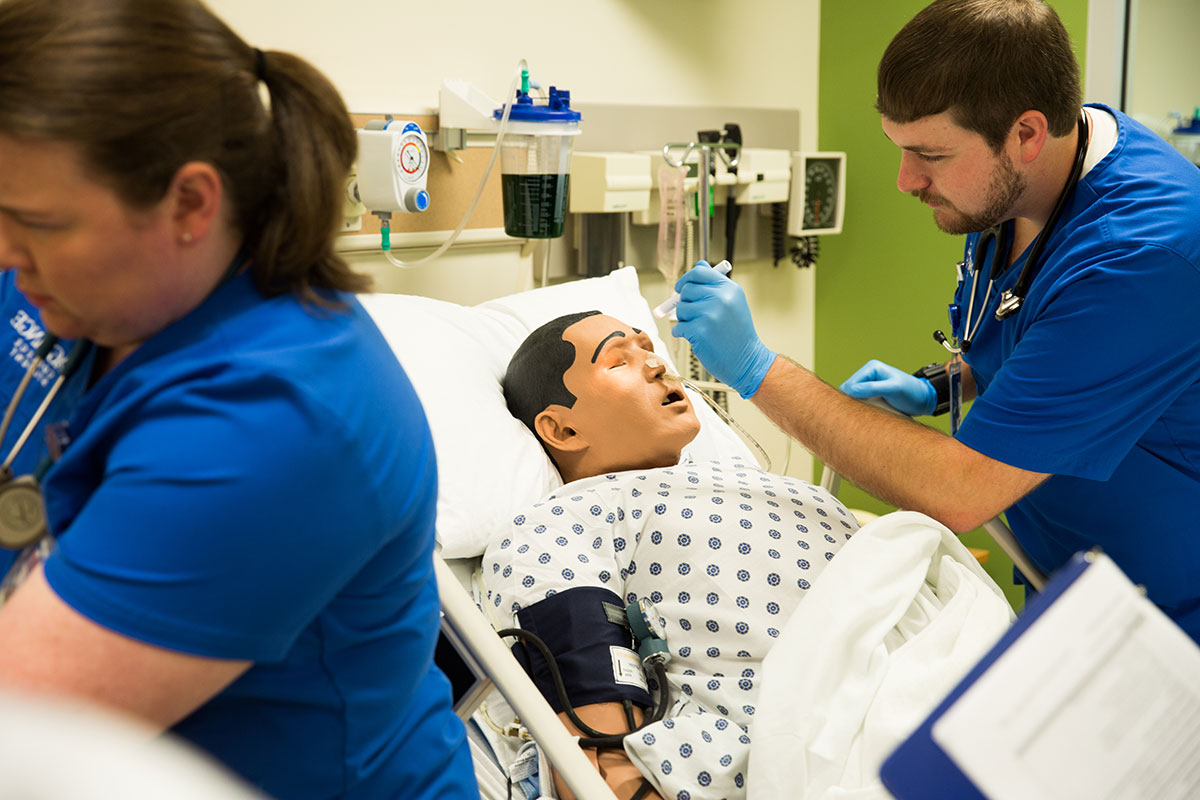 A nursing student practices his skills on a mechanical patient in one of LaGrange College's classrooms.